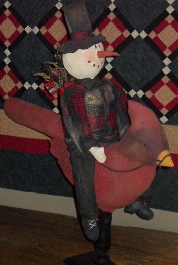 Snowman riding Cardinal